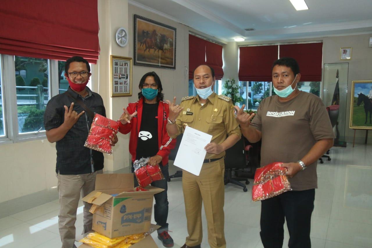 Sihar Beri Bantuan APD ke Kabupaten Tapanuli Utara